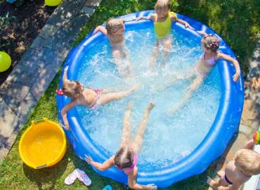 https://www.shutterstock.com/image-photo/little-boy-inflatable-swimming-pool-outdoor-464059643